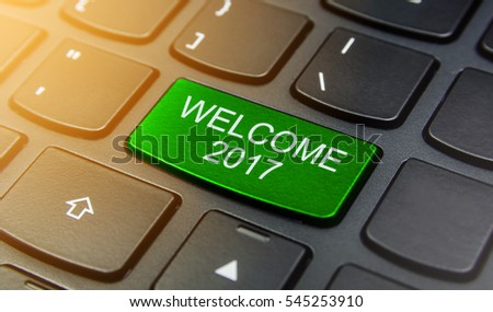 Close-up the Welcome 2017 button on the keyboard and have Green color button isolate black keyboard