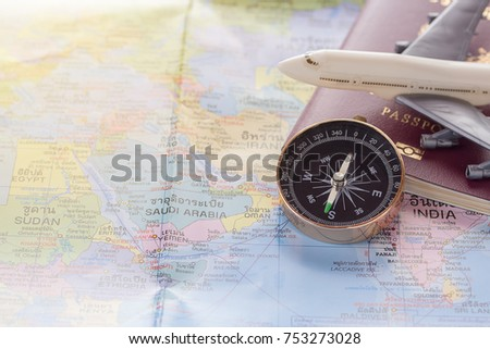 Close white toy airplane passport on stock photo 753273577 close up the white toy airplanecompass and passport on the world map background gumiabroncs Images
