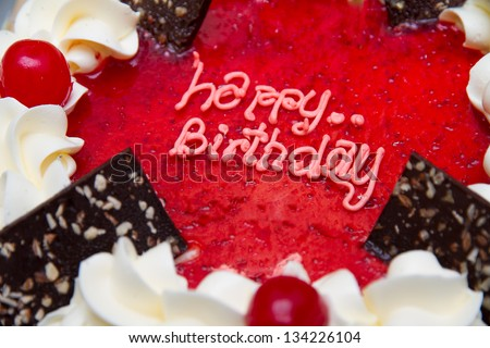 "close up the word ""Happy Birthday"" on the cake. - stock photo"