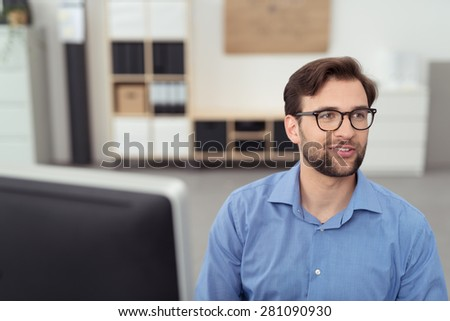 Close up Thoughtful Handsome Businessman with Eyeglasses, Sitting at his Desk and Looking at the Distant. - stock photo
