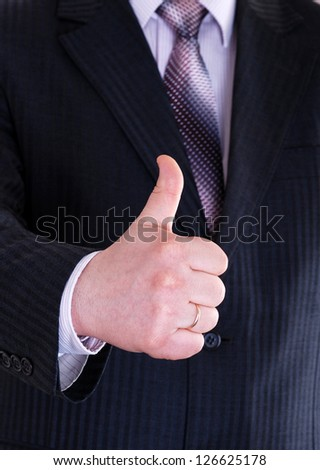 close-up thumb up - stock photo