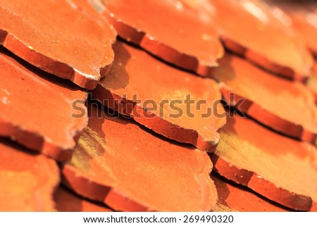 Close up Tile roofs of the old church temple. In Thailand. - stock photo