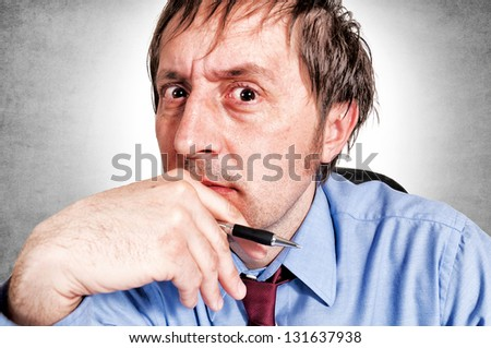 Close up to angry boss face - stock photo
