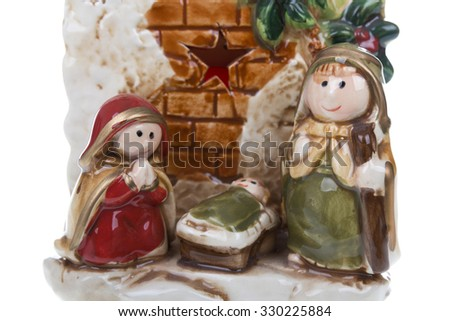Close up to Christmas nativity scene with the Virgin Mary, St. Joseph and baby Jesus. Isolated on white background. Stock photography. - stock photo