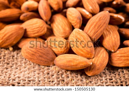 Close up to heap of raw almonds  - stock photo