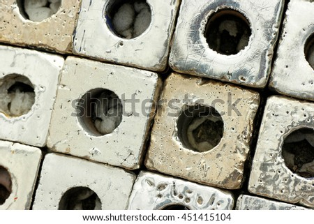 Close up to many metallic or chrome color of ceramic cube art blocks with circle hole at public park, Ratchaburi, Thailand. - stock photo