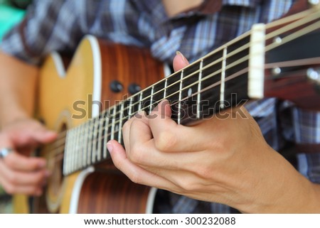Close up to the hand of guitar player / soft focus