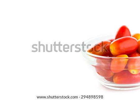 Close up tomatoes in cup on white background.