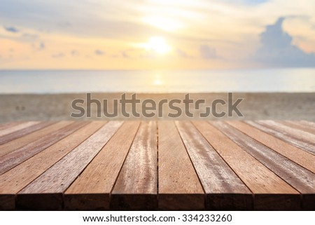 Close up top of wooden table at sunset beach. Can use for product display - stock photo