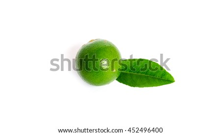 Close-up top view group of whole fresh picked green raw limes and leaves isolated on white background. Organic food concept with clipping path and copy space. Panorama style. - stock photo