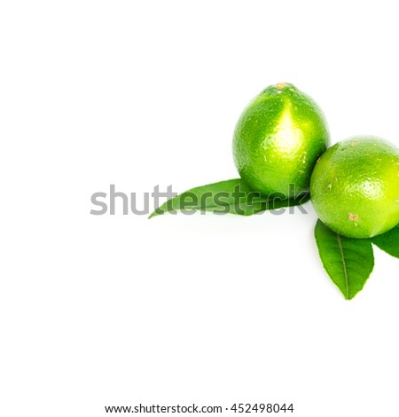 Close-up top view group of whole fresh picked green raw limes and leaves isolated on white background. Organic food concept with clipping path and copy space.