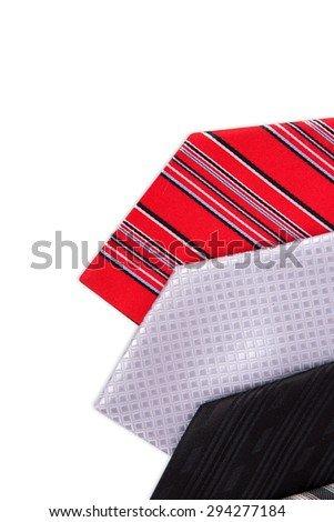 Close up top view of colorful men ties side by side, isolated on white background.