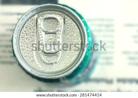 close up top view of cool green canned drink with water condensation - stock photo