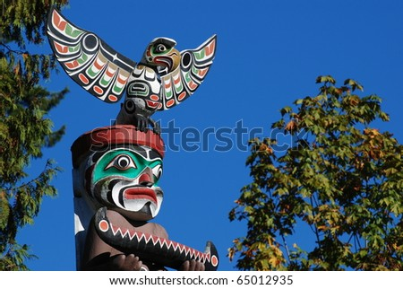 Close-up Totem shaped in Stanley park, BC Canada - stock photo