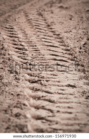 Close up  trace of a tyre in the sand - stock photo