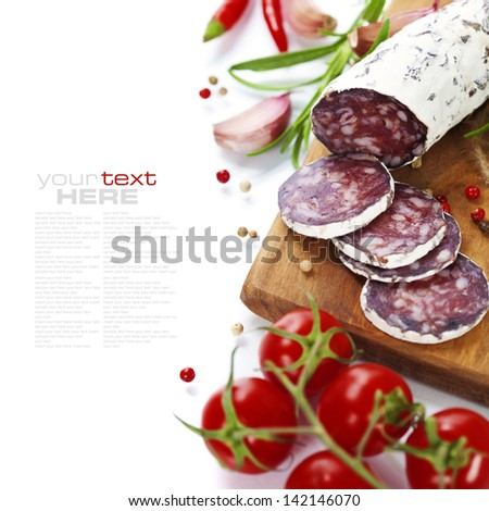 Close-up traditional sliced meat sausage salami on wooden board - stock photo