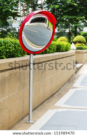Close up traffic convex mirror near car park entrance - stock photo