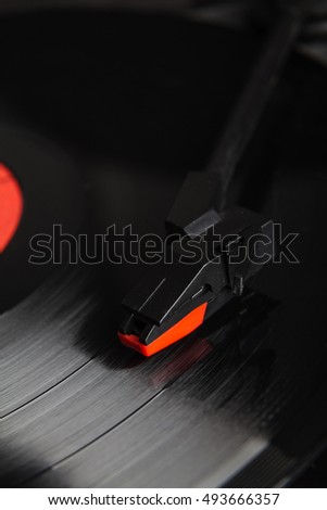 Close-up turntable needle and vinyl disk