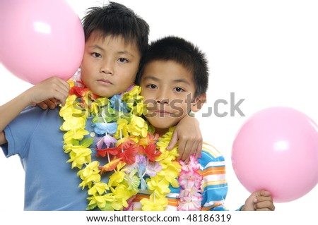 Close up two children with colorful balloons - stock photo