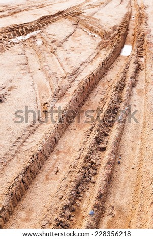 Close up tyre tracks on marshy road