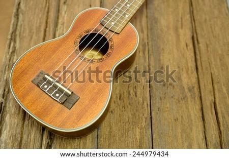 Close up ukuleles on wooden background. - stock photo