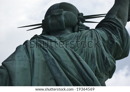 Close-up, upper section, Statue of Liberty from back showing head and part of right arm against the sky, New York City, USA