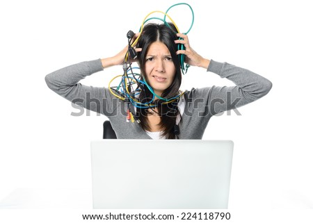 Close up Upset Woman in Gray Long Sleeve Shirt Putting Tangled Network Cables on Her Head While Experiencing No Internet Connection to her Laptop. Looking at the Camera. Isolated on White Background. - stock photo
