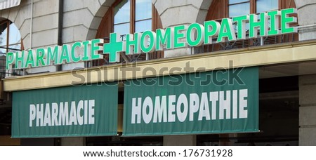 Close up urban view of french homeopathic drugstore in the street - stock photo