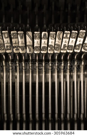Close-up Vertical Photograph of Used Metal Typebars - stock photo