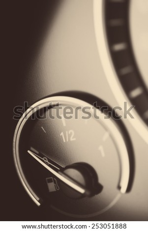 Close-up vertical shot of a fuel gauge in a car. - stock photo
