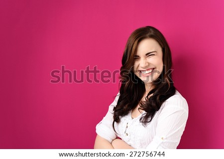 Close up Very Happy Young Pretty Woman with Arms Crossed Over her Stomach Against Pink Background With Copy Space. - stock photo