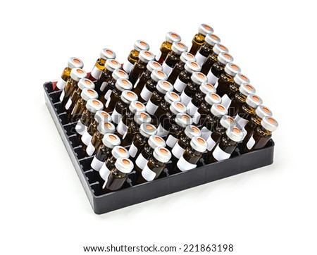 Close up Vials with inserts and crimp septum caps in plastic rack for liquid analysis isolated on white - stock photo