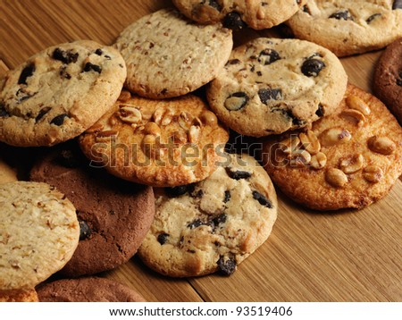 close up view cookies over wooden background - stock photo