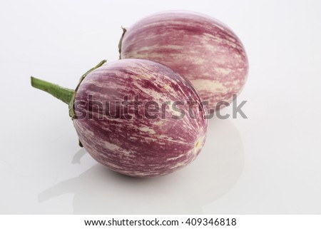 Close-up view  fresh organic raw ripe Eggplant (or Brinjal) Colourful vegetable   - stock photo