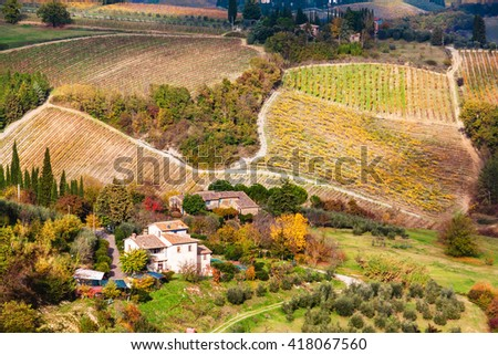 Close up view from San Gimignano on houses and fields in autumn, Tuscany, Italy - stock photo