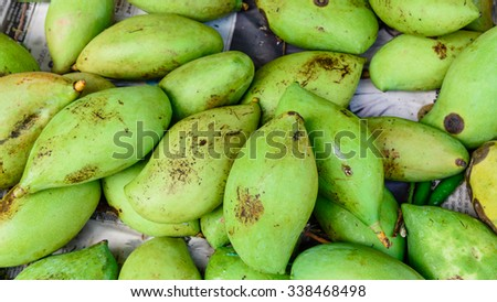 Close-up view group of fresh organic raw green Mangoes on display at Vegetable and Fruit Stall of Local Market at Little India, Singapore. Colorful fruit background, healthy concept. Panoramic style - stock photo