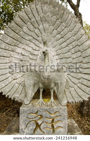 Close up view of a beautiful bird statue on a park. - stock photo