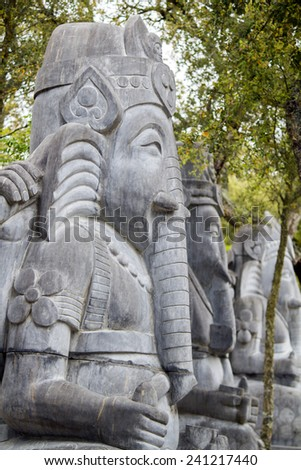 Close up view of a beautiful elephant statue on a park. - stock photo