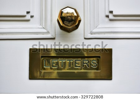 Close-up View of a Beautiful Letter Box on a House Front Door - stock photo
