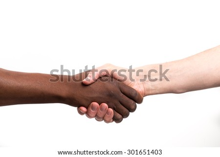 Close up view of a black / african man and a white / caucasian man shaking hands