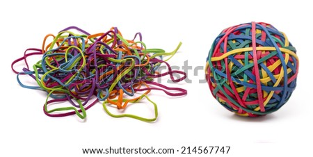 Close up view of a colorful elastic rubber band ball and a unordered pile isolated on a white background.