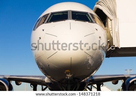 Close up view of a commercial passenger airliner. - stock photo