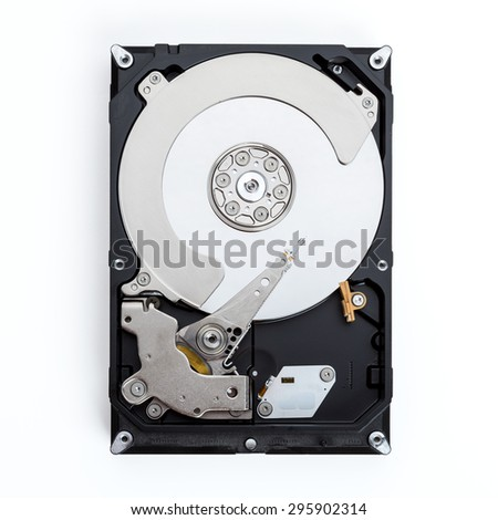 Close up view of a computer hard drive isolated on a white background. - stock photo