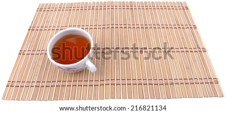 Close up view of a cup of tea on bamboo mat - stock photo