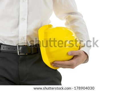 Close up view of a engineer carrying a yellow hardhat under his arm. Isolated over white, with copyspace. - stock photo