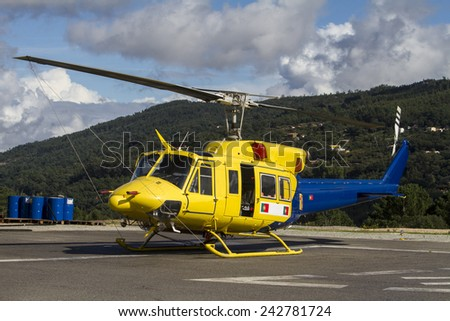 Close up view of a fire fighter helicopter parked. - stock photo