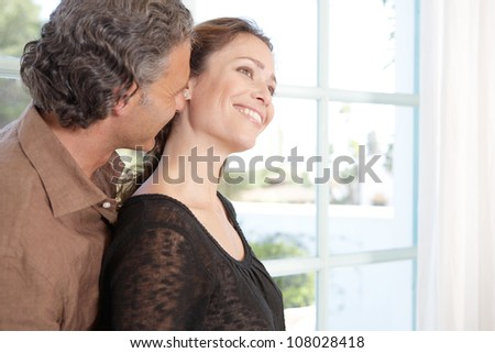 Close up view of a mature couple being affectionate at home. - stock photo
