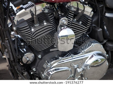 Close up view of a motorbike engine - covers of cylinders and gearbox