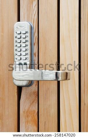 Close-up View of a Pass Code Door Handle Lock - stock photo
