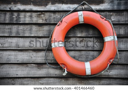 Close-up View of a Seaside Life Buoy on a Wooden Wall